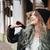 jóvenes · dama · sombrero · escuchar · música - foto stock © deandrobot