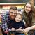幸せな家族 · ポーズ · カメラ · 階 · リビングルーム - ストックフォト © deandrobot
