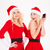 funny playful sisters twins in santa claus dresses and hats stock photo © deandrobot