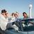 grupo · alegre · amigos · conducción · cabriolé · cielo - foto stock © deandrobot