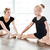 happy little girl ballerina sitting and stretching legs with teacher stock photo © deandrobot