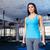 aranyos · fitnessz · nő · tart · súlyzók · testmozgás · kék - stock fotó © deandrobot