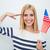 szczęśliwy · patriotyczny · kobieta · banderą · patrząc - zdjęcia stock © deandrobot