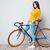 feliz · casual · mulher · em · pé · bicicleta - foto stock © deandrobot