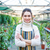 beautiful happy young woman gardener in colorful striped apron stock photo © deandrobot