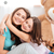 two cheerful charming sisters embracing at home stock photo © deandrobot