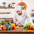 concentrated chef cook standing and cutting fresh vegetables stock photo © deandrobot