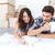 happy couple looking at construction house plan stock photo © deandrobot