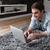 человека · ноутбука · диван · молодым · человеком · домой - Сток-фото © deandrobot