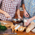 Hands of couple beating eggs and cooking together on kitchen stock photo © deandrobot