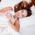 belle · jeune · femme · oreiller · lit · portrait - photo stock © deandrobot