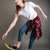 joyful pretty young woman riding on skateboard and having fun stock photo © deandrobot