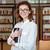 fókuszált · női · könyvtáros · tart · tankönyv · könyvtár - stock fotó © deandrobot