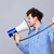 man directing megaphone at herself stock photo © deandrobot