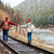 couple walking on old railroad in mountains stock photo © deandrobot