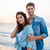 beautiful young couple standing and smiling on the beach stock photo © deandrobot