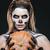 closeup of woman with gothic skeleton makeup holding pumpkin stock photo © deandrobot