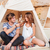 couple sitting and smiling in wigwam on the beach stock photo © deandrobot