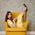 függőleges · kép · megrémült · nő · fotel · citromsárga - stock fotó © deandrobot