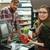 Happy cashier woman on workspace in supermarket stock photo © deandrobot