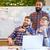 gens · d'affaires · présentation · utilisant · un · ordinateur · portable · ensemble · bureau - photo stock © deandrobot