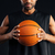 cropped image of a concentrated african basketball player holding ball stock photo © deandrobot