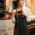 young woman waiter standing in cafe looking aside stock photo © deandrobot