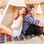 couple sitting and resting near wigwam on the beach stock photo © deandrobot