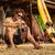 jóvenes · masculina · surfista · pie · playa · tabla · de · surf - foto stock © deandrobot