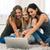 három · barátok · laptop · számítógép · ül · kanapé · számítógép - stock fotó © deandrobot