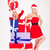 two smiling woman in santa cloth standing with present boxes stock photo © deandrobot