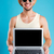 happy man in hat and sunglasses holding blank screen laptop stock photo © deandrobot
