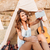 woman taking selfie with smartphone in wigwam on the beach stock photo © deandrobot