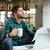 小さな · ビジネスマン · 座って · 表 · オフィス - ストックフォト © deandrobot