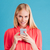 portrait of a smiling beautiful woman holding mobile phone stock photo © deandrobot