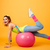 Sports woman posing over yellow background with fitness ball stock photo © deandrobot