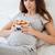 terhes · nő · tart · has · ágy · hóbortos · külső - stock fotó © deandrobot