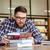 mężczyzna · student · posiedzenia · biurko · myślenia · książek - zdjęcia stock © deandrobot
