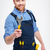 smiling male builder holding wrench stock photo © deandrobot