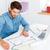 imprenditore · seduta · desk · diagrammi · laptop · isolato - foto d'archivio © deandrobot