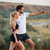 young beautiful fitness couple standing on a hill stock photo © deandrobot