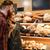 happy loving couple in supermarket choosing pastries stock photo © deandrobot