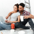 happy loving couple on floor in new flat using laptop stock photo © deandrobot