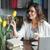 sorridente · mulher · madura · trabalhando · laptop · tabela - foto stock © deandrobot
