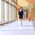 businesswoman walking along the office corridor stock photo © deandrobot