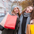 two women holding shopping bags stock photo © deandrobot