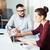 gericht · zakenman · vergadering · met · behulp · van · laptop · werkplek · kantoor - stockfoto © deandrobot
