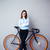 smiling businesswoman standing near bicycle stock photo © deandrobot