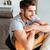 boldog · férfi · ül · kanapé · fókusz · gitár - stock fotó © deandrobot