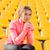 sports woman resting at stadium stock photo © deandrobot